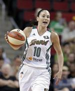 <p>FILE - In this July 31, 2014 file photo, Seattle Storm's Sue Bird plays against the Indiana Fever in a WNBA basketball game in Seattle. Now 34 and part of an overhauled Seattle Storm roster with two new stars 13 years her junior, Bird is adding a new role to her professional resume: mentor. (AP Photo/Elaine Thompson, File)</p>