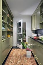 <p>This Beverly Hills kitchen that has dark olive green cabinets and a textured black stone countertop. (AP Photo/Burnham Design, Sarah Dorio)</p>