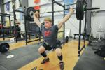 <p>Sam Kwant has made himself into a top-notch CrossFit competitor. Scott Terrell / Skagit Valley Herald</p>