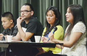 Panelists speak Friday night during the Mount Vernon High School Democrats, Dreamers, Believers, Achievers Club and LEAP Club community forum on the Washington DREAM Act in the high school auditorium. From left are Guillermo Mogollan, Edgar Franx, Barbara Guzman and Fanny Gonzales.