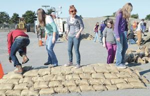 Students pile 'em high during Flood Awareness Week