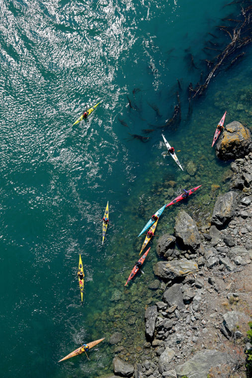 <p>Kayakers float in Deception Pass on Saturday during the Washington State Parks centennial celebration.</p>