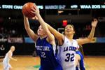 <p>La Conner's Anna Cook, right, battles for a rebound with Toutle Lake's Bailey Hockett during the first quarter of a State 2B Girls Basketball Tournament quarterfinal game on Thursday, March 5, 2015 at the Spokane Veterans Memorial Arena in Spokane, Wash. (Pete Caster / Centralia Chronicle)</p>