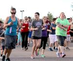 <p>Runners take off at the starting line at the Logan Aquatic Center for the Take Back The Night CAPSA 5K and 1-mile Walk on Friday evening.</p>
