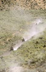 <p>A line of ATVs moves down the mountainside in Box Elder County on Sept. 11, 2010.</p>