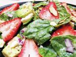 <p>Baby spinach leaves combine with sliced strawberries, avocado, gorgonzola and crumbled bacon in this springtime salad. Leslie Collings / Port Susan Farmers Market</p>