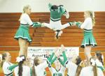 <p>Mount Vernon High School cheerleader Mikaela Thomas, center, is flipped through the air during the large group stunt performance at the third annual Skagit County Cheer Competition on Saturday, March 21, at Mount Vernon High School. Brandy Shreve / Skagit Publishing</p>