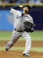 <p>Seattle Mariners starting pitcher Felix Hernandez delivers to the Tampa Bay Rays during the first inning of a baseball game, Wednesday, May 27, 2015, in St. Petersburg, Fla. (AP Photo/Chris O'Meara)</p>