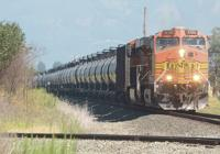 <p>A 110-car-long oil train makes its way Wednesday, July 30, 2014, toward March Point in Anacortes along Highway 20 near Fredonia. Scott Terrell / Skagit Valley Herald</p>