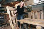 <p>Donna Zang moves a pallet in her garage workshop in Pleasant Hills, Pa. (John Heller/Pittsburgh Post-Gazette/TNS)</p>