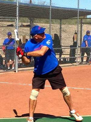 <p>Dick Sievers of the Insurance Center of Green Valley team smacks a pitch.</p>