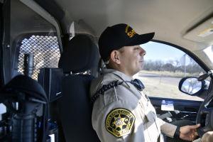Santa Cruz County Sherriff's Deputy Omar Rodriquez patrols the U.S./Mexico border outside of Nogales, Ariz., on Feb. 19, 2013, as a part of his daily duties.