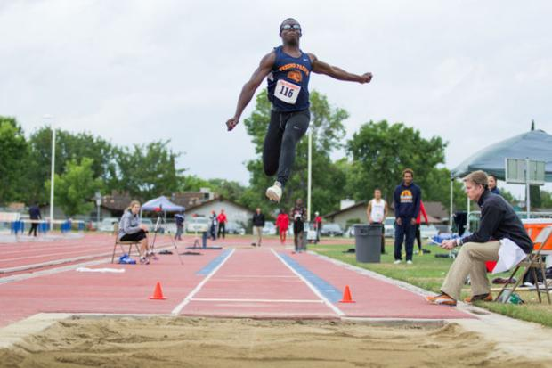 Donte McDaniel jumping over the competition