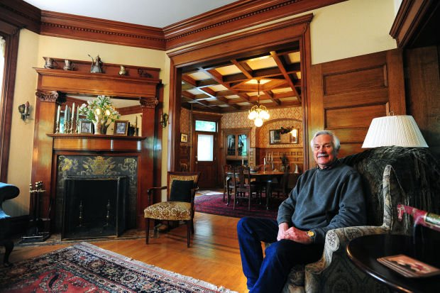Ron Lee sits in the living room of his 1898 Queen Anne-style home