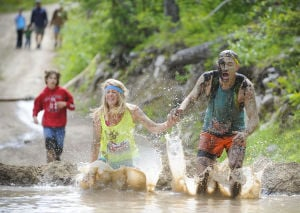 Hundreds run a-muck at Great Divide obstacle race