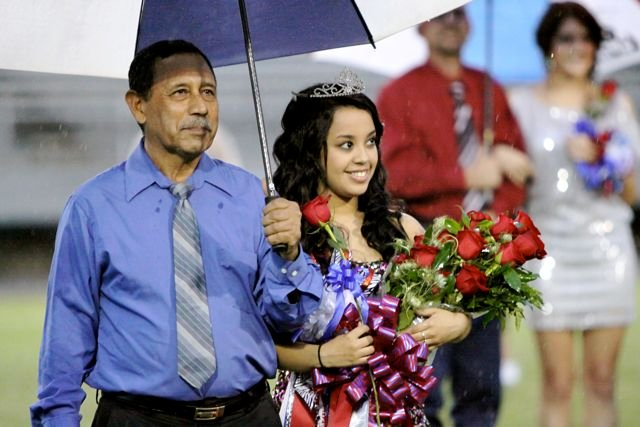 Homecoming queen Karen Morales and father Pedro Morales.jpg