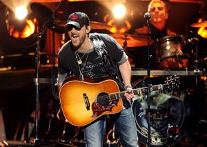 Column: Guitar solos are getting the ax in country music songs