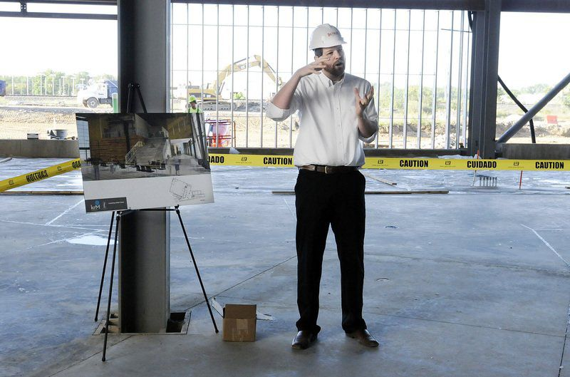 Matt Yates of KRM talks about the Purdue Polytechnic Anderson during a tour of the project June 9. - Herald Bulletin photo