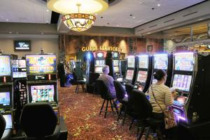<p>Players demonstrate the slot machines at The Pokagon Band of Potawatomi Indians' Four Winds Dowagiac during media day in 2013 when the casino first opened. Construction on the casino's expansion will take place this spring.</p>