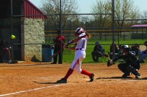 <p>Lakeshore's Rachel Clem hits a two-run home run during a game against Dowagiac in Saturday's Lakeshore Invitational.</p>
