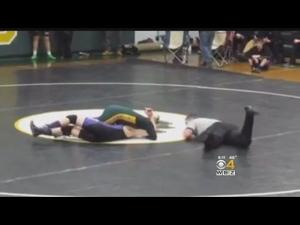 Video: Undefeated wrestler gives up record to teen with down syndrome