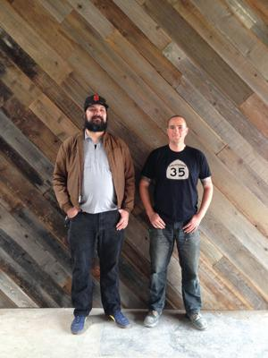 <p>Gabriel Lucas, left, and Jesse Ferarris stand in the unfinished front room of Redwood Coast Cider's brewery in San Carlos. They hope to complete the tasting room construction through a Kickstarter campaign that ends on Sunday.</p>