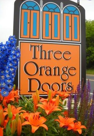 Three Orange Doors