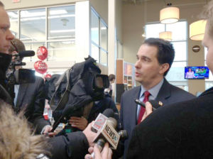 Scott Walker, whose office once had a secret email, hits Hillary Clinton over email flap