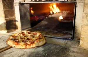 A brick oven, sunset and music make magic at Cress Spring Bakery's 'pizza on the farm'