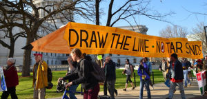 Madison environmental, social justice advocates converge in Library Mall march and protest