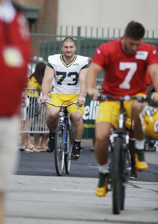 JC Tretter on bike at training camp file photo AP