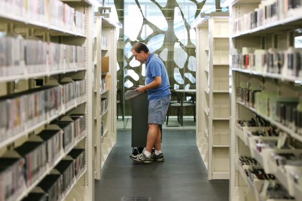 Shelving DVDs at the new library