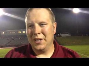La Follette football coach Scott Swanson gets soaked as he talks to our Jason Galloway
