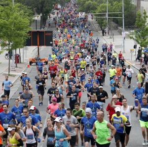 Photos: Runners brave a soggy Madison Half Marathon