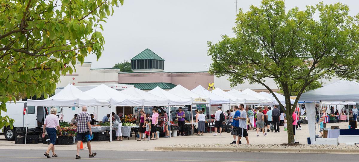 People visit the sunday northside farmers market on at northside