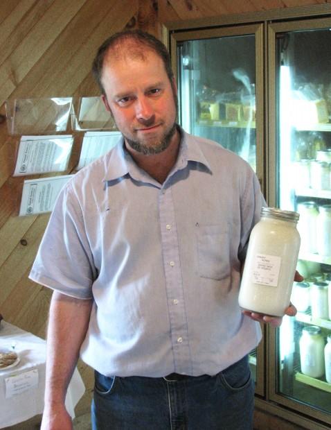 Loganville farmer Hershberger holds raw milk