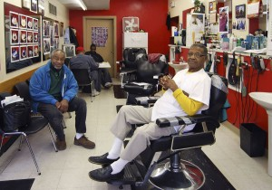 Mr. Smitty (seated in chair) and his barber shop in South Madison are ...