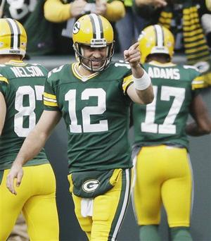 Photos: Packers roll to victory over Carolina