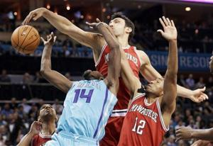 Photos: Hornets sting Bucks with OT loss in season opener