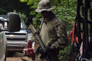 Mining company Gogebic Taconite has hired armed, paramilitary-style guards to patrol the site where it wants to build an open-pit iron mine in the Penokees of northern Wisconsin.