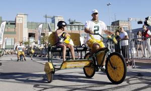 Packers photos: Big men, small bikes