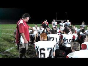 Milton football breaks its postgame huddle after beating Stoughton