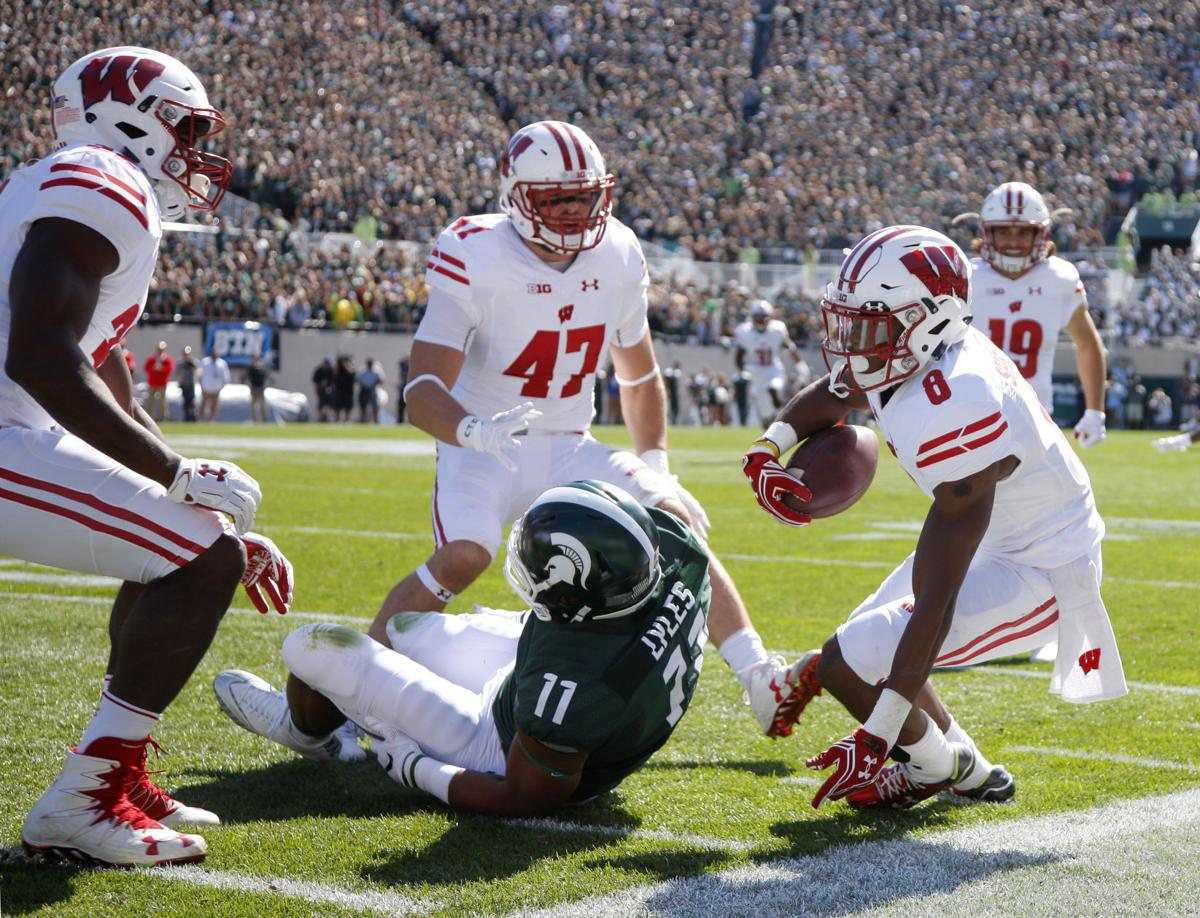 badgers football  no  11 wisconsin dominates no  8 michigan state to remain undefeated