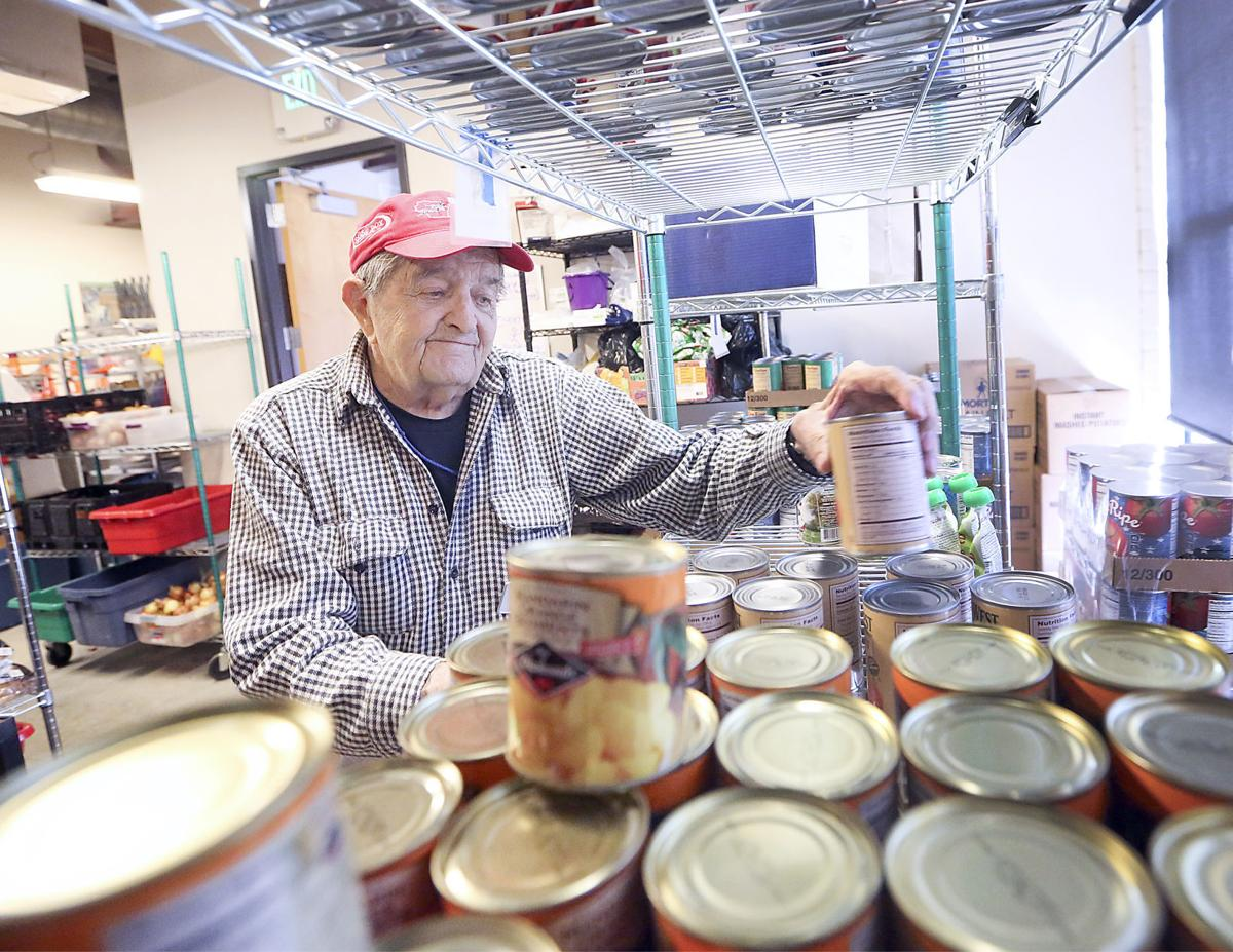 Volunteers encourage others to give spare time madison for Madison food pantry volunteer