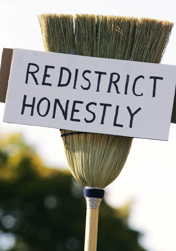 """redistrict honestly"" broom sign from 2005 protest"