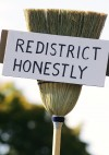 """""""redistrict honestly"""" broom sign from 2005 protest"""