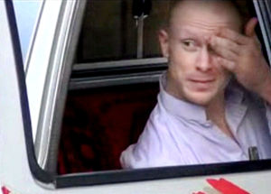 <p>In this image taken from video obtained from Voice Of Jihad Website, which has been authenticated based on its contents and other AP reporting, Sgt. Bowe Bergdahl, sits in a vehicle guarded by the Taliban in eastern Afghanistan.</p>