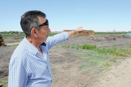 <p>Demeter Bio-Resources Chief Operating Officer Sot Chimonas points to the area where the company hopes to get a conditional use permit to build an ethanol plant as part of a food processing facility in Caldwell. Wednesday, April 29, 2015 (Greg Kreller/IPT)</p>