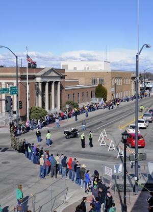 <p>Over 800 volunteers line up for a book brigade to pass around 1,000 books from the Nampa Public Library to Library Square Saturday in downtown Nampa. Saturday, Feb 21, 2015 Adam Eschbach/IPT</p>