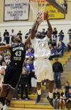 <p>College of Idaho senior guard Demetrius Perkins (11 points, 12 rebounds) goes up for a basket before getting fouled by Oregon Tech's Sherman Simpson on Wednesday in the Cascade Conference quarterfinals at the College of Idaho. The College of Idaho won the game 71-64.</p>